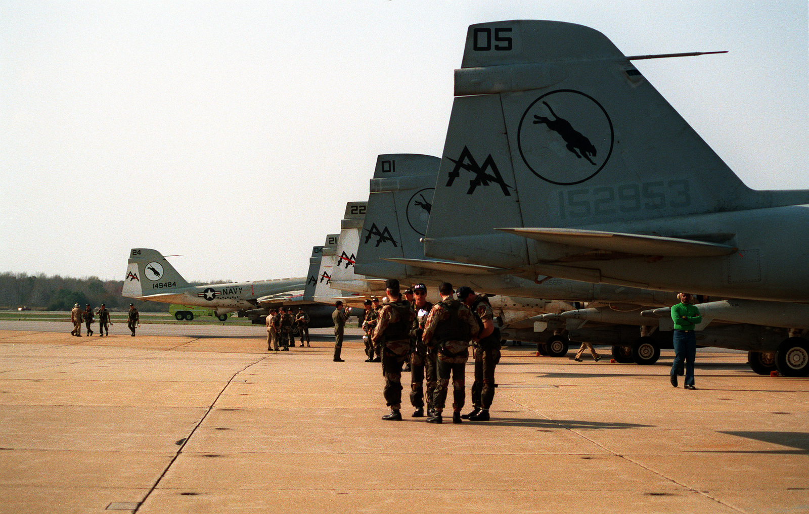 Several Attack Squadron 35 (VA-35) flight crews gather near the tails of their A-6E Intruder aircraft as they wait for the squadron's remaining aircraft to taxi into place on the flight line. VA-35 has returned to Oceana following its deployment to the Persian Gulf region aboard the aircraft carrier USS SARATOGA (CV-60) for Operation Desert Shield and Operation Desert Storm