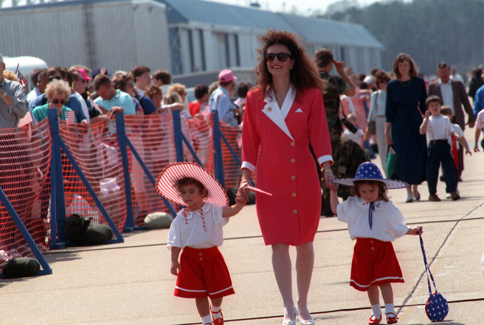 The wife and children of a naval aviator wait on the flight line for his return. The F-14A Tomcat aircraft and A-6E Intruder aircraft squadrons of Carrier Air Wing 3 (CVW-3) and Carrier Air Wing 17 (CVW-17) are returning to Oceana following their participation in Operation Desert Shield and Operation Desert Storm. CVW-3 and CVW-17 were deployed in the Red Sea aboard the aircraft carriers USS JOHN F. KENNEDY (CV-67) and USS SARATOGA (CV-60), respectively
