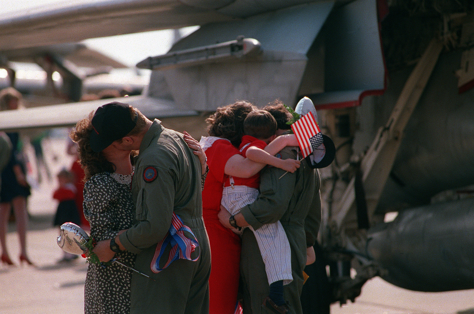 Two naval aviators are reunited with their families. The F-14A Tomcat aircraft and A-6E Intruder aircraft squadrons of Carrier Air Wing 3 (CVW-3) and Carrier Air Wing 17 (CVW-17) are returning to Oceana following their participation in Operation Desert Shield and Operation Desert Storm. CVW-3 and CVW-17 were deployed in the Red Sea aboard the aircraft carriers USS JOHN F. KENNEDY (CV-67) and USS SARATOGA (CV-60), respectively