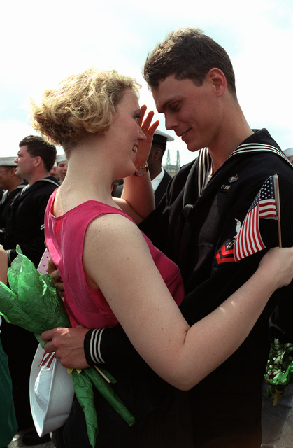 A sailor and his wife are reunited on the pier. Five ships of the aircraft carrier USS SARATOGA (CV-60) battle group are returning to Mayport today after serving in the Persian Gulf region during Operation Desert Shield and Operation Desert Storm