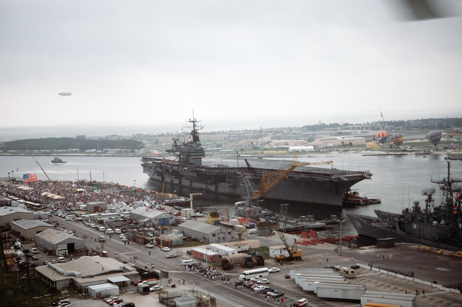 tug boats move the aircraft carrier uss saratoga cv 60 toward the