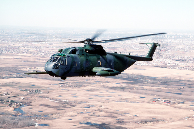 A 71st Air Rescue Squadron (71st ARS) HH-3E Jolly Green Giant helicopter flies over Canada en route to Aircraft Maintenance and Regeneration Center at Davis-Monthan Air Force Base, Arizona. Helicopters from the 71st ARS are being relocated in preparation for the squadron's deactivation on June 1, 1991. The 210th Rescue Squadron, Air National Guard, will take over Alaskan rescue missions