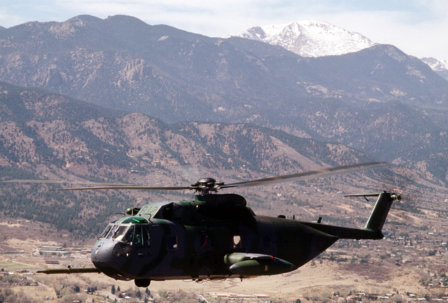 A 71st Air Rescue Squadron (71st ARS) HH-3E Jolly Green Giant helicopter flies near Pike's Peak en route to the Aircraft Maintenance and Regeneration Center at Davis-Monthan Air Force Base, Arizona. Helicopters from the 71st ARS are being relocated in preparation for the squadron's deactivation on June 1, 1991. The 210th Air Rescue Squadron, Air National Guard, will take over Alaskan rescue missions