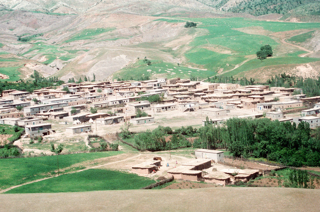 An aerial view of a Kurdish village near the Turkey-Iraq border. Thousands of Kurds fled into Turkey after fighting broke out between Kurdish groups and Iraqi government forces following Operation Desert Storm. Troops from the U.S. and other nations are working at the Kurdish refugee camps to distribute aid and prepare the refugees for a move to organized camps within Iraq as part of Operation Provide Comfort