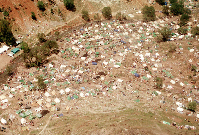 An aerial view of one of the Kurdish refugee camps near the Turkey-Iraq border. Thousands of Kurds fled into Turkey after fighting broke out between Kurdish groups and Iraqi government forces following Operation Desert Storm. Troops from the U.S. and other nations are working at the camps to distribute aid and prepare the refugees for a move to organized camps within Iraq as part of Operation Provide Comfort