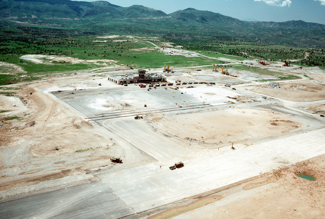 An aerial view of part of an Iraqi airfield being repaired by members of a Naval Mobile Construction Battalion 133 (NMCB-133) air detachment. The Seabees are repairing the airfield, which had been under construction prior to the start of the Persian Gulf war, to allow relief supplies to be flown in for nearby Kurdish refugees as part of OPERATION PROVIDE COMFORT