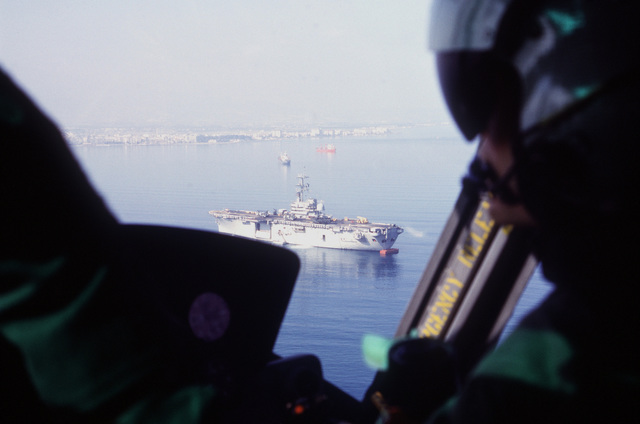As seen from aboard a UH-1 Iroquois helicopter, the amphibious assault ship USS GUADALCANAL (LPH-7) lies anchored in Iskenderun Bay to offload elements of the 24th Marine Expeditionary Unit (24th MEU) during Operation Provide Comfort, a multinational effort to aid Kurdish refugees in northern Iraq and southern Turkey