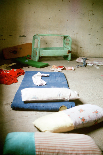 Discarded belongings of a Kurdish refugee family litter a deserted barracks which they used as a shelter while fleeing the forces of Saddam Hussein in northern Iraq