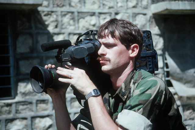 Journalist 2nd Class Greg Milota videotapes operations as Marines confiscate Iraq weapons during Operation Provide Comfort. The filming is being conducted for Navy News
