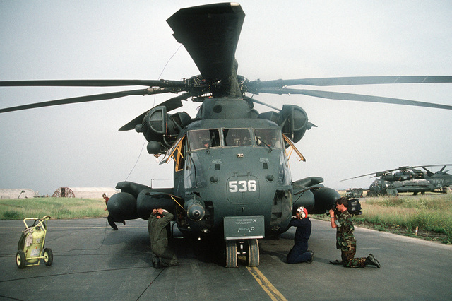 Journalist 2nd Class Greg Milota videotapes the preflight check of a Helicopter Combat Support Squadron 4 (HC-4) CH-53E Super Stallion helicopter during Operation Provide Comfort