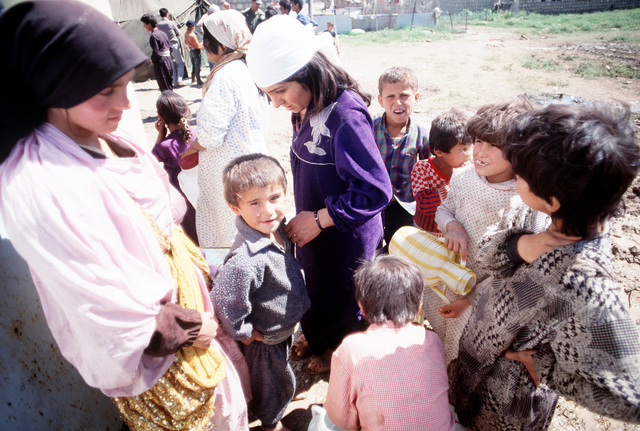 Kurdish refugee children prepare to take containers to a well at their tent city near Zakhu. The camp was established as part of Operation Provide Comfort, an Allied effort to aid refugees who fled the forces of Saddam Hussein in northern Iraq