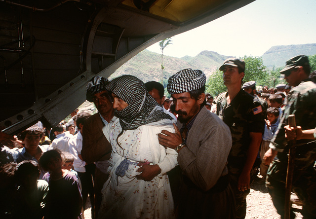 Kurdish refugees board a U.S. Army CH-47 Chinook helicopter for transfer from their mountain camp to a newly established tent city at Zakhu. The tent city was established as part of Operation Provide Comfort, an Allied effort to aid Kurdish refugees who fled the forces of Saddam Hussein in northern Iraq