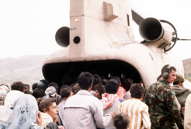 Kurdish refugees gather around a CH-47 Chinook helicopter delivering supplies to a camp site set up by Allied forces. Camp sites are being set up along the Turkey-Iraq border as part of Operation Provide Comfort, an Allied effort to aid refugees who fled from the forces of Saddam Hussein in northern Iraq