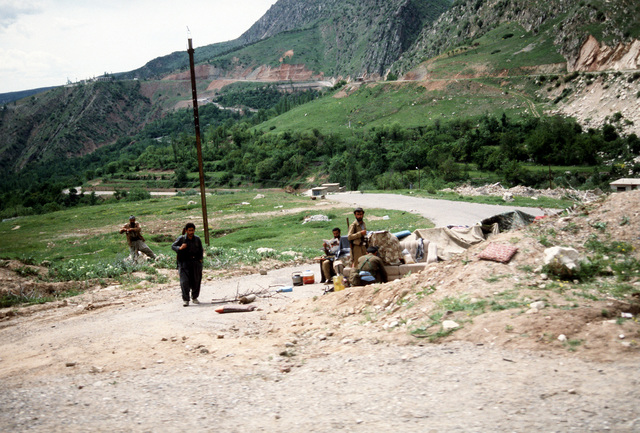 Kurdish refugees pause with their possessions on a road near their destination, a tent city at Zakhu. The refugees are fleeing the forces of Saddam Hussein in northern Iraq and will receive aid from Allied forces as part of Operation Provide Comfort