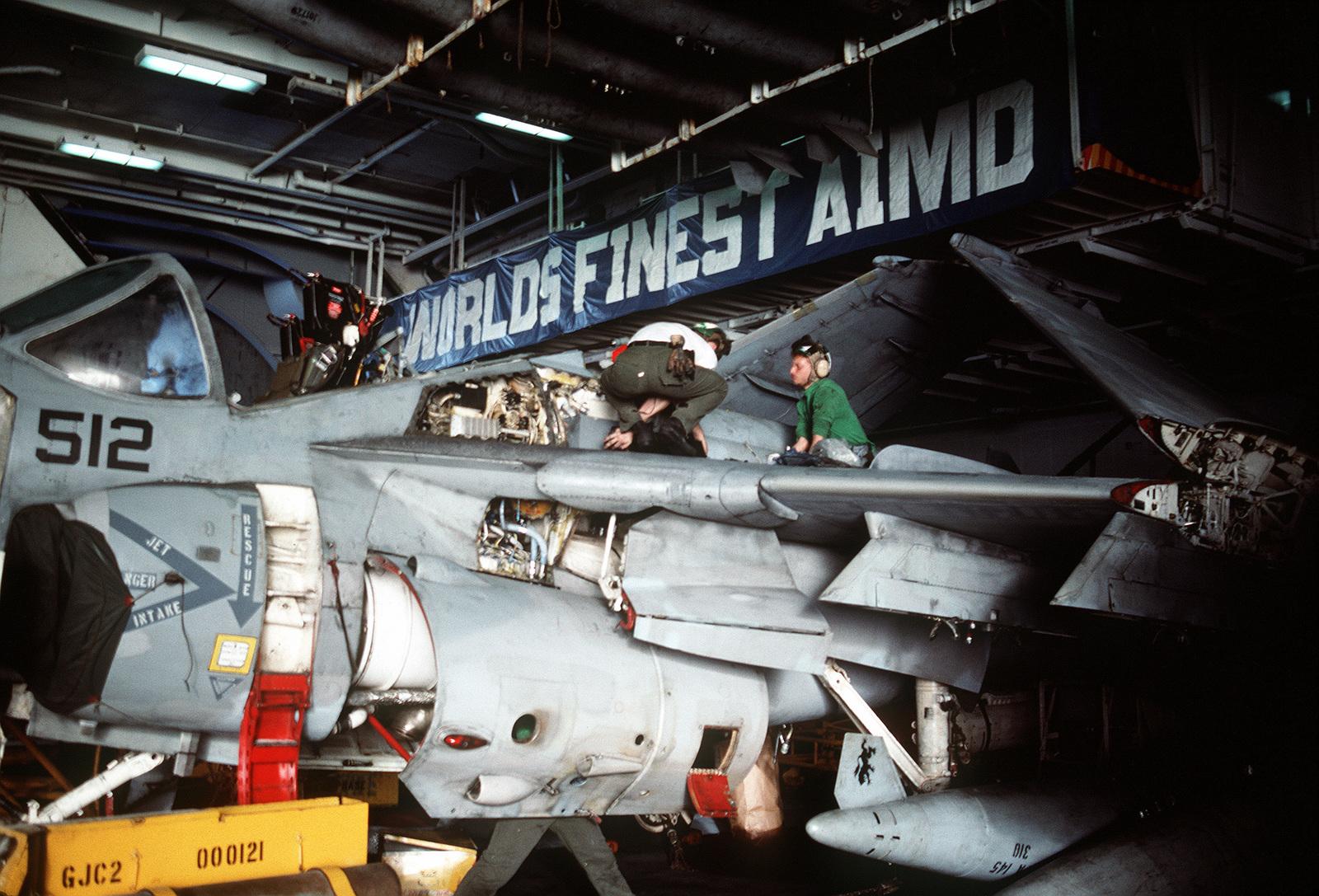 Maintenance crewmen work on an Attack Squadron 145 (VA-145) A-6E Intruder aircraft on the hangar deck of the aircraft carrier USS RANGER (CV-61). The RANGER is on station in the Persian Gulf region following Operation Desert Storm