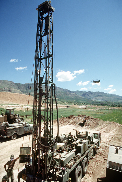 Members of Naval Mobile Construction Battalion 133 use a 600-foot water well drilling system as they drill as well near a Kurdish refugee tent city. The work is being done as part of Operation Provide Comfort, an Allied effort to aid refugees who fled the forces of Saddam Hussein in northern Iraq