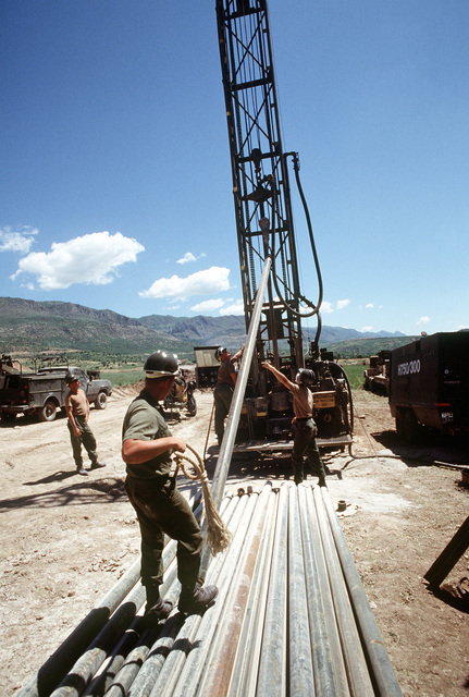Members of Naval Mobile Construction Battalion 133 use a 600-foot water well drilling system as they drill a well near a Kurdish refugee tent city. The work is being done as part of Operation Provide Comfort, an Allied effort to aid refugees who fled the forces of Saddam Hussein in northern Iraq
