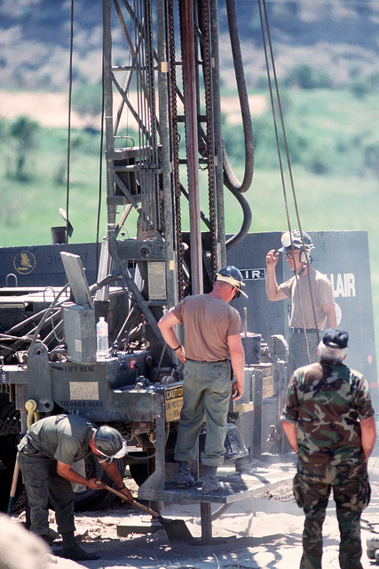 Members of Naval Mobile Construction Battalion 133 uses a 600-foot water well drilling system as they drill a well near a Kurdish refugee tent city. The work is being done as part of Operation Provide Comfort, an Allied effort to aid refugees who fled the forces of Saddam Hussein in northern Iraq