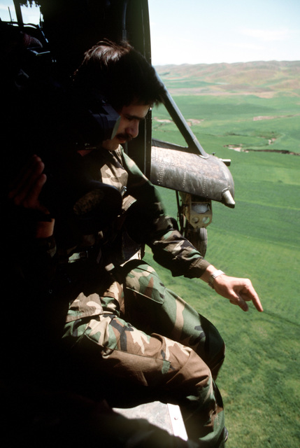PO2 Gregory Milota of Navy Broadcasting Service films Kurdish refugee camps from a helicopter during Operation Provide Comfort, an Allied effort to aid the refugees who fled from the forces of Saddam Hussein in northern Iraq