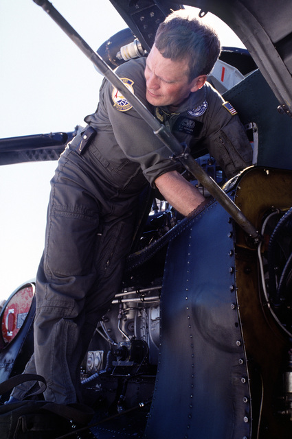 SGT Gerald D. Howsden, crew chief with the 616th Consolidated Aircraft Maintenance Squadron, works on a 71st Air Rescue Squadron (71st ARS) HH-3E Jolly Green Giant helicopter following a malfunction en route to Aircraft Maintenance and Regeneration Center at Davis-Monthan Air Force Base, Arizona. Helicopters from the 71st ARS are being relocated in preparation for the squadron's deactivation on June 1, 1991. The 210th Rescue Squadron, Air National Guard, will take over Alaskan rescue missions