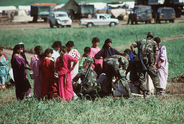 Soldiers fill containers with purified water for Kurdish refugees on the outskirts of a tent city near Zakhu. Such necessities are being provided as part of Operation Provide Comfort, an Allied effort to aid those fleeing the forces of Saddam Hussein in northern Iraq