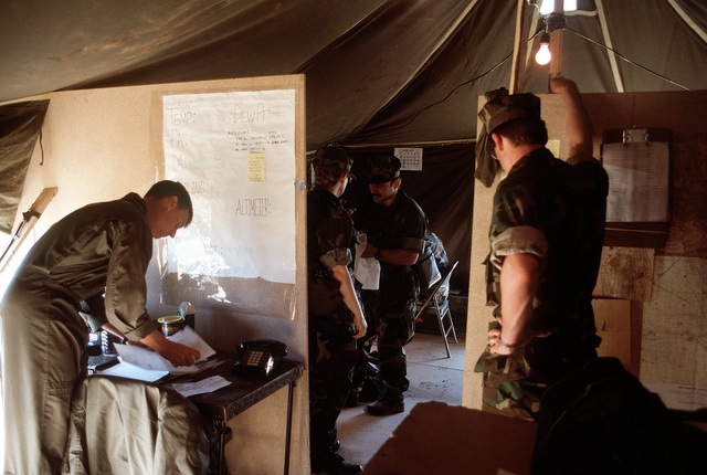 U.S. military personnel coordinate the day's activities in their base camp, situated near a Kurdish refugee camp at Silopi. Military personnel are in the area as part of Operation Provide Comfort, an Allied effort to aid the refugees who fled from the forces of Saddam Hussein in northern Iraq