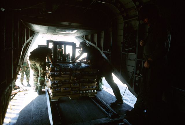 U.S. military personnel load supplies onto a CH-53E Super Stallion helicopter. The material will be delivered to Kurdish refugees as part of Operation Provide Comfort, an Allied effort to aid the refugees who fled from the forces of Saddam Hussein in northern Iraq