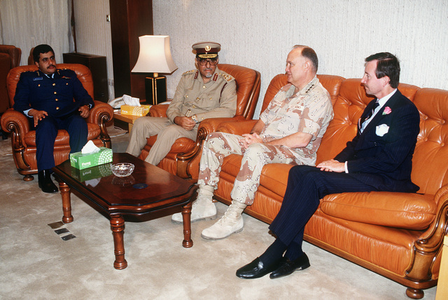 GEN. Norman Schwarzkopf, commander-in-chief, U.S. Central Command, meets with, from left: LT. COL. Hamad Ali Al Hinzab, Brig. GEN. Muhammed Bin Abdullah Al-Attiyah, and Mark G. Hambley, U.S. ambassador to Qatar. Schwarzkopf is visiting Qatar and other coalition countries that assisted in ousting Iraqi forces from Kuwait during Operation Desert Storm.