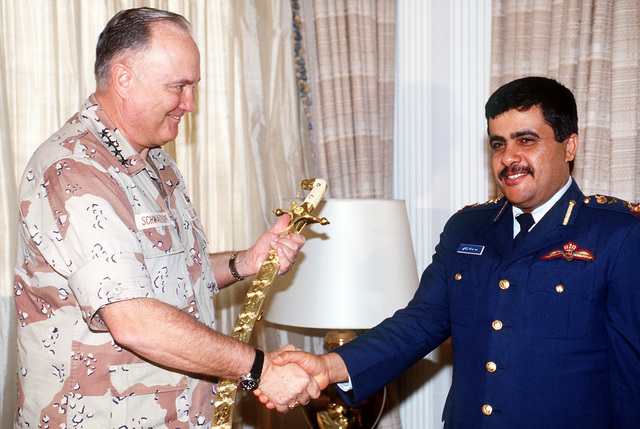 GEN. Norman Schwarzkopf, commander-in-chief, U.S. Central Command, receives a sword from LT. COL. Hamad Ali Al Hinzab. The general is being presented with the gift as a token of appreciation for his role in liberating Kuwait from occupying Iraqi forces during Operation Desert Storm.