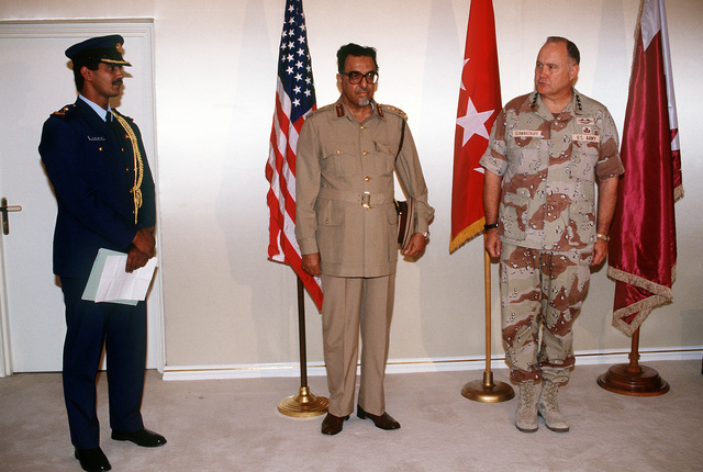 GEN. Norman Schwarzkopf, commander-in-chief, U.S. Central Command, stands beside Brig. GEN. Muhammed Bin Abdullah Al-Attiyah during a ceremony prior to presenting the Qatarian general with the Legion of Merit. Abdullah Al Attiyah is receiving the award for his role in liberating Kuwait from occupying Iraqi forces during Operation Desert Storm.