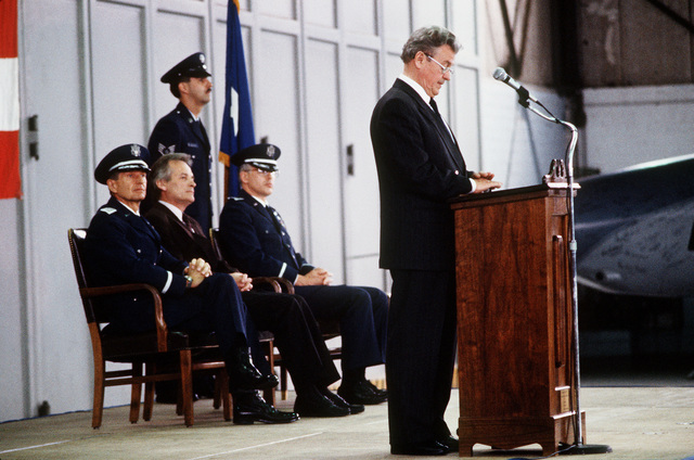 Werner Vonblon, mayor of the city of Zweibrucken, speaks during a ceremony marking the inactivation of the 26th Tactical Reconnaissance Wing (26th TRW). Seated behind him are, from left: MGEN James E. Chambers, commander, 17th Air Force; Rudi Geil, minister of the interior for the state of Rheinland Pfalz; and COL Kenneth Funkhauser, right, commanding officer of the 26th TRW