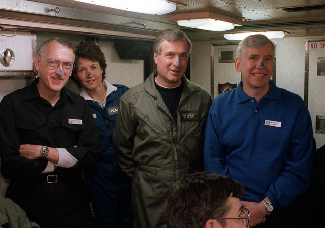"""Guests aboard the nuclear-powered attack submarine USS PARGO (SSN 650) take part in a """"blue-nose"""" ceremony to mark their first trip above the Arctic Circle. They are, from left: RADM Millard S. Firebaugh, SSN-21 (Seawolf) direct reporting program manager; CAPT Dorothy A. Prose, executive assistant to the undersecretary of the Navy; Robert McCormack, assistant secretary of the Navy for financial management; Robert Schafer, House Armed Services Committee (HASC) staff member; and Wade Heck, (HASC) staff member."""
