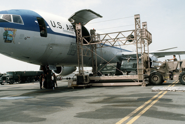 Equipment is loaded aboard a KC-10A Extender aircraft, dubbed Bayou Babe, for redeployment to the United States in the aftermath of Operation Desert Storm