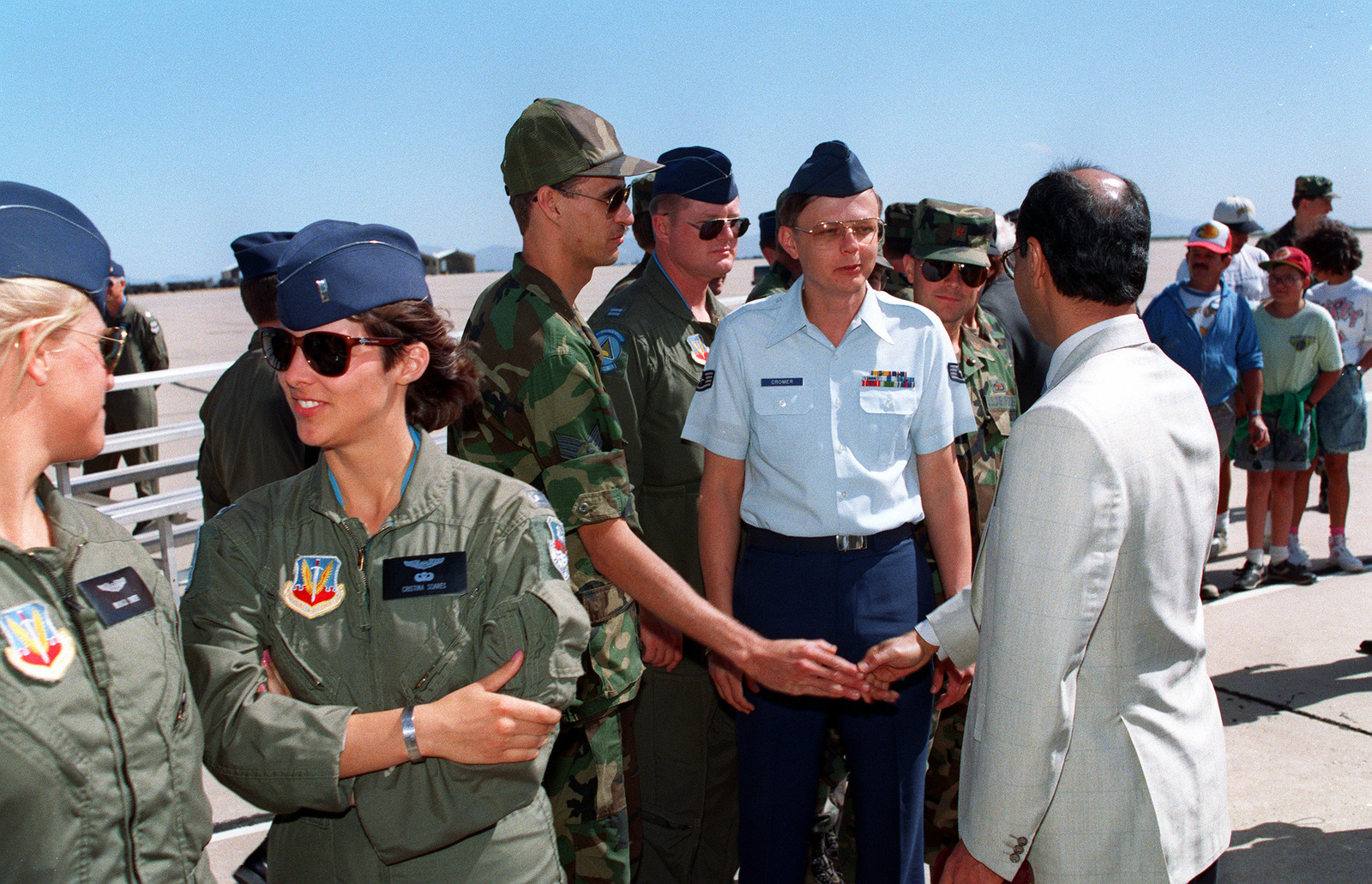 Sheikh Saud Nasir Al Sabah, third from right, Kuwait's ambassador to the U.S., shakes the hand of an airman as he makes his way through a crowd of well-wishers. Al Sabah has come to Davis-Monthan to thank the base's personnel for their role in Operation Desert Shield and Operation Desert Storm, which liberated Kuwait from its Iraqi invaders