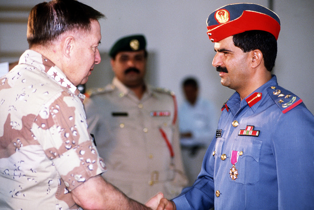 LT. GEN. Charles A. Horner, commanding general, U.S. Central Air Force, greets base commander Brig. GEN. Rashid Mubarek Al-Riamy during a tour of coalition forces after Operation Desert Storm.