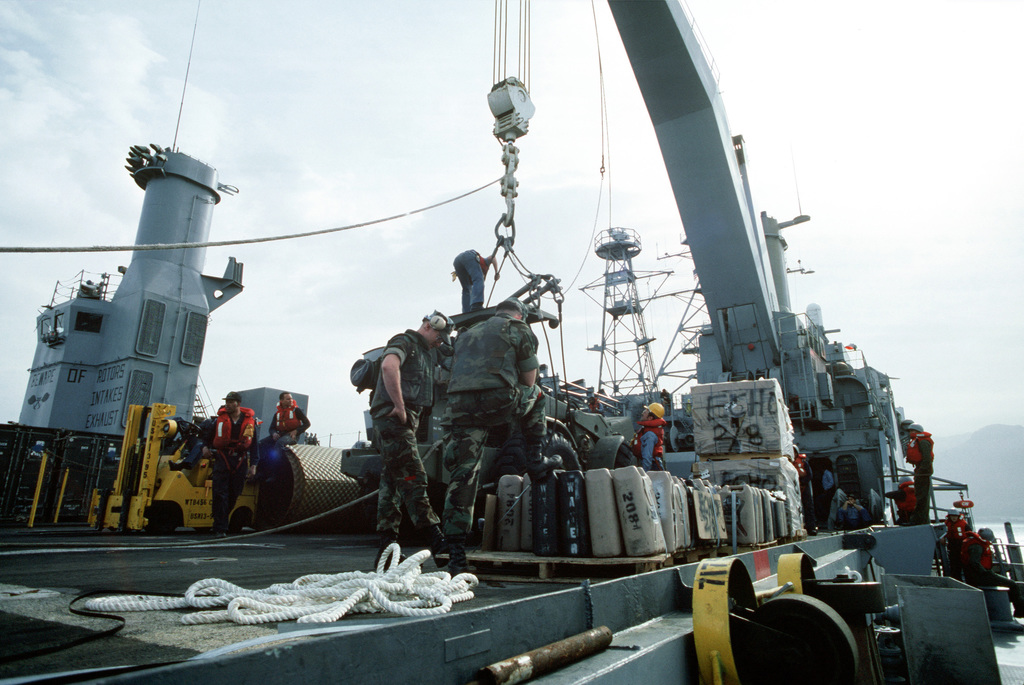 Marines organize supplies and equipment aboard the amphibious transport dock USS AUSTIN (LPD-4) in preparation for going ashore to take part in Operation Provide Comfort, an Allied effort to aid Kurdish refugees who fled the forces of Saddam Hussein in northern Iraq