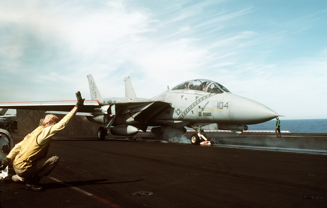 A catapult officer aboard the aircraft carrier USS AMERICA (CV-66) gives the signal to launch a Fighter Squadron 102 (VF-102) F-14A Tomcat aircraft. The aircraft of Carrier Air Wing 1 (CVW-1) are returning to their home bases after being deployed aboard the AMERICA for Operation Desert Shield and Operation Desert Storm. The AMERICA and its battle group will return to Naval Station, Norfolk, Va., on April 18th