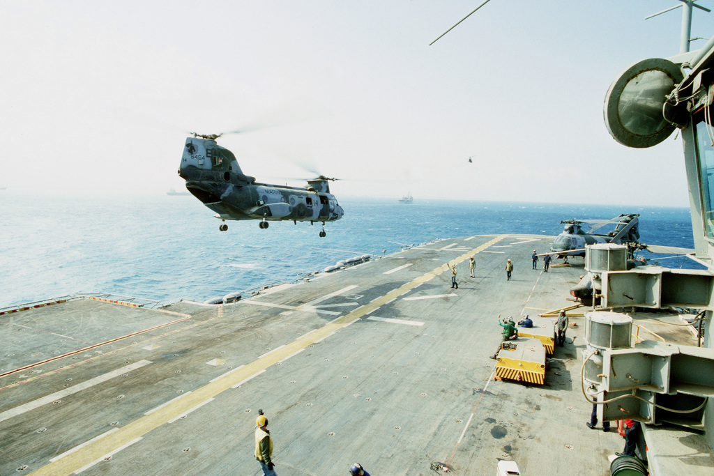A Marine Medium Helicopter Squadron 264 (HMM-264) CH-46E Sea Knight helicopter prepares to touch down on the flight deck of the amphibious assault ship USS GUADALCANAL (LPH-7) during vertical replenishment operations. The helicopter is delivering supplies and equipment to be used by Marines onshore during Operation Provide Comfort, an Allied effort to aid Kurdish refugees who fled the forces of Saddam Hussein in northern Iraq