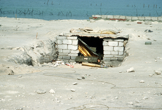 Artillery shells are abandoned in an Iraqi beachfront defense post in the aftermath of Operation Desert Storm.