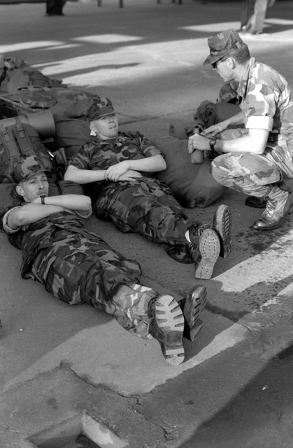 Marines from the 24th Marine Expeditionary Unit (24th MEU) relax as they wait for transportation to the humanitarian services support base set up in Silopi, Turkey. Marines of the 24th MEU are taking part in Operation Provide Comfort, the multinational effort to provide relief for Kurdish refugees fleeing from Iraqi government forces