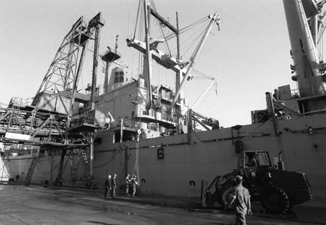 The amphibious cargo ship USS CHARLESTON (LKA-113) stands at the pier as equipment is offloaded during Operation Provide Comfort, an Allied effort to aid Kurdish refugees who fled from the forces of Saddam Hussein in northern Iraq