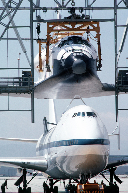 The NASA 747 Shuttle Carrier Aircraft (SCA) in position beneath the Space Shuttle Endeavour OV-105 (Orbiter Vehicle-105), suspended with a massive lifting structure, at Rockwell International's Air Force Plant 42, Site 1, at Palmdale. The shuttle will be attached to the 747 SCA for transporting to the Kennedy Space Center, FLorida. Exact Date Shot Unknown