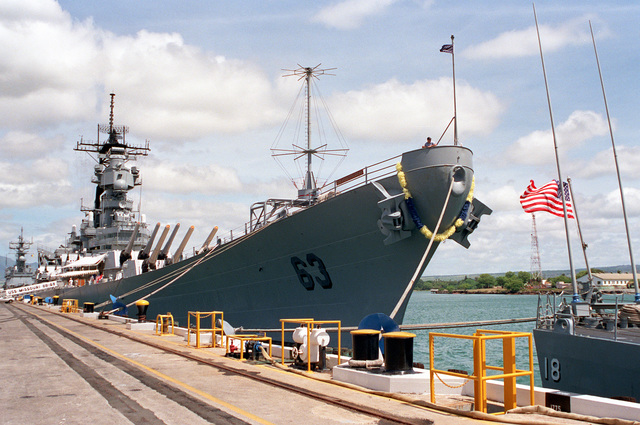 A flower lei hangs around the bow of the battleship USS MISSOURI (BB-63) during its visit to the naval station. The MISSOURI has stopped at Pearl Harbor during its return voyage to Naval Station, Long Beach, Calif., after serving in the Persian Gulf region during Operation Desert Shield and Operation Desert Storm.