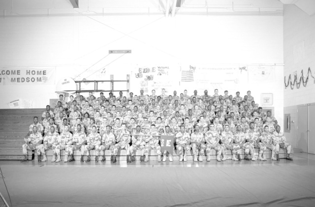 A group portrait of the soldiers of the 808th Engineer Company prior to the units demobilization. The company is a reserve unit that was called to active duty during Operation DESERT SHIELD