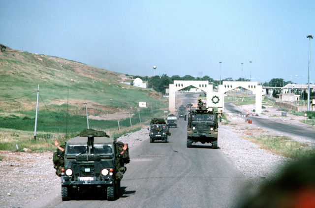 British airportable light vehicles and an M-939 5-ton cargo truck pass over the Turkey/Iraq border. Allied servicemen are in the area in support of Operation Provide Comfort efforts to aid the Kurdish refugees who fled the forces of Saddam Hussein in northern Iraq