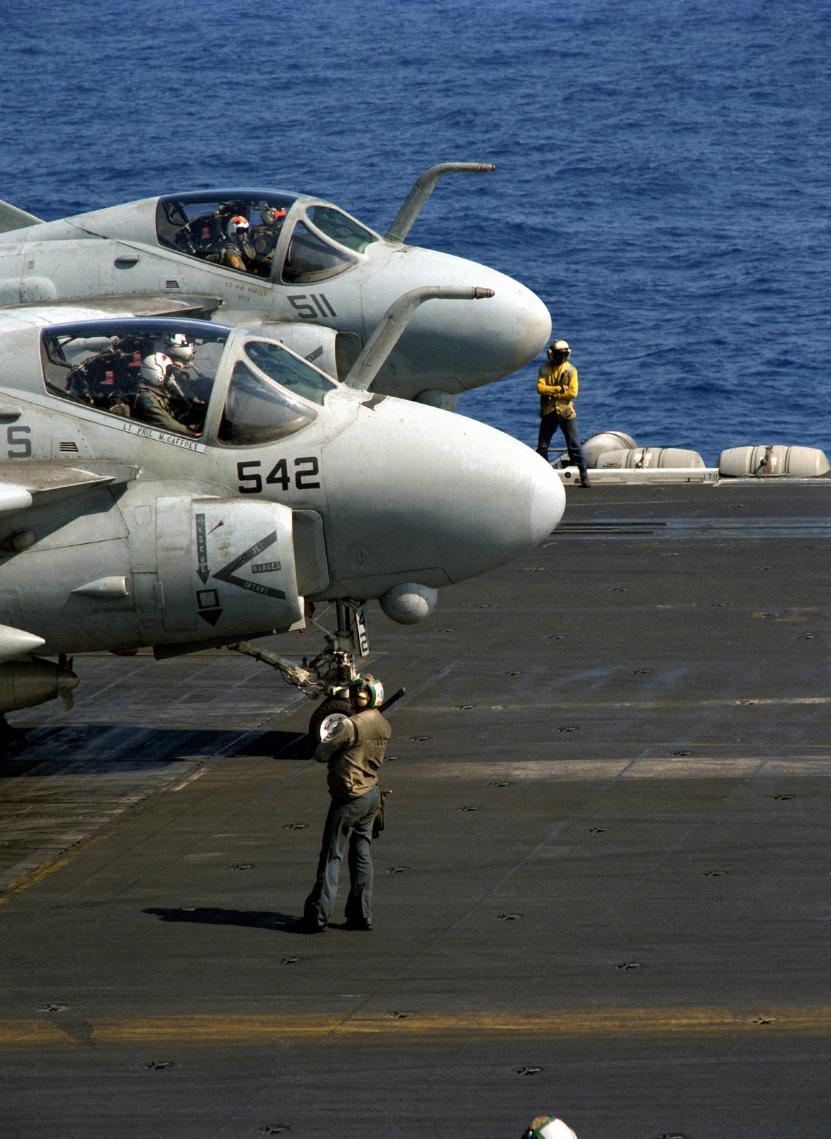 A-6E Intruder aircraft from Attack Squadron 36 (VA-36), foreground, and Attack Squadron 65 (VA-65) wait to taxi into position for launch on the flight deck of the nuclear-powered aircraft carrier USS THEODORE ROOSEVELT (CV-71). The ROOSEVELT is on station in the eastern Mediterranean to support Operation Provide Comfort, a multinational effort to aid Kurdish refugees in southern Turkey and northern Iraq.