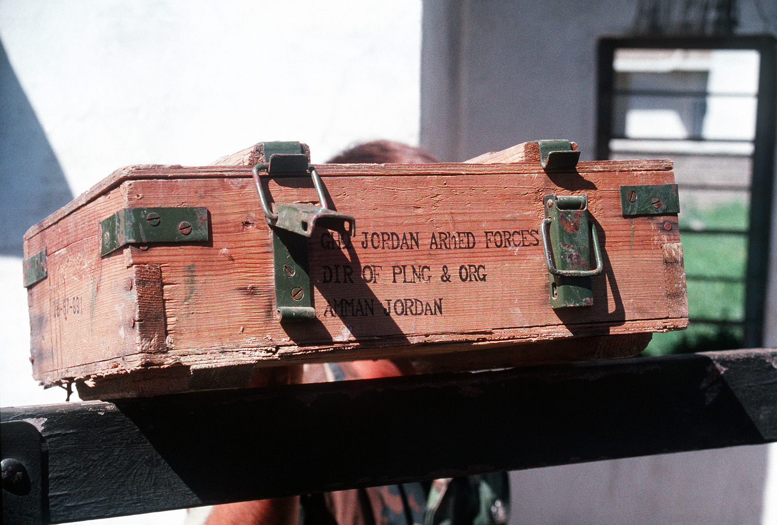 An ammunition crate bearing Jordanian markings is displayed after being recovered from an abandoned building by the Marines of an explosive ordnance disposal (EOD) team attached to Marine Expeditionary Unit (MEU) Service Support Group 24 (MSSG-24). The disposal of discarded Iraqi munitions is being conducted in conjunction with Operation Provide Comfort, a multinational effort to aid Kurdish refugees in northern Iraq and southern Turkey