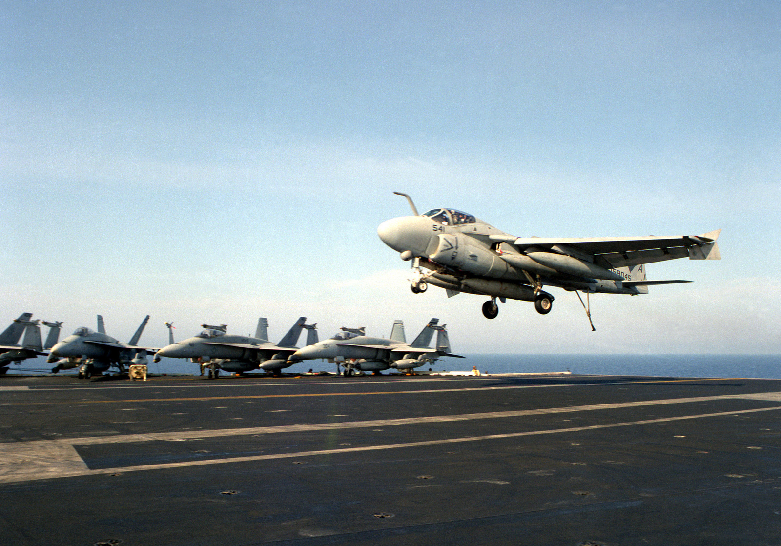 An Attack Squadron 36 (VA-36) A-6E Intruder aircraft comes in for an arrested landing on the flight deck of the nuclear-powered aircraft carrier USS THEODORE ROOSEVELT (CVN-71). The ROOSEVELT is on station in the eastern Mediterranean to support Operation Provide Comfort, a multinational effort to aid Kurdish refugees in southern Turkey and northern Iraq.
