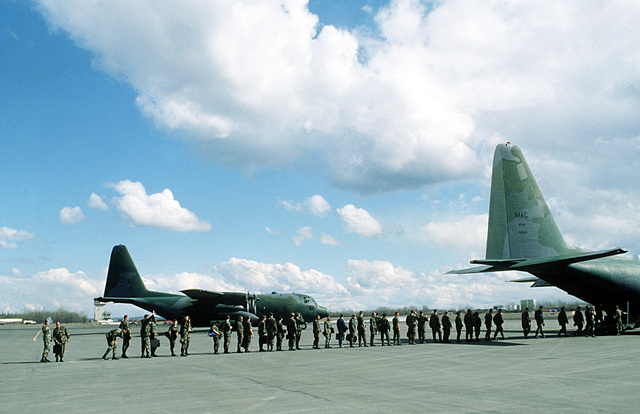 Evacuees from Galena Airport board a 17th TActical Airlift Squadron C-130 Hercules aircraft as they prepare to depart from the facility to avoid flooding in the area