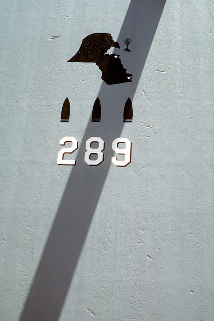 "Artillery shells and the country of Kuwait are outlined on the forward gun turret of the battleship USS MISSOURI's (BB-63) Mark 7 16-inch 50-caliber guns while the number ""289"" signifies the number of shots fired by the forward guns during MISSOURI's participation in Operation Desert Storm. The vessel has just returned to Naval Station, Long Beach, following its Persian Gulf deployment"